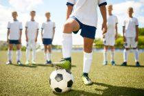 Kommunikation zwischen Fußballtrainer und Spielern
